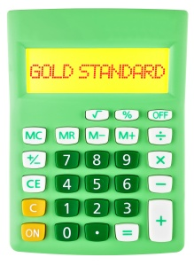 Calculator with GOLD STANDARD on display on white background
